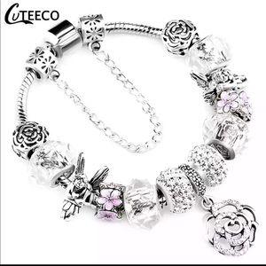 Jewelry - Brand New Pink Rose Angel Charm Bracelet
